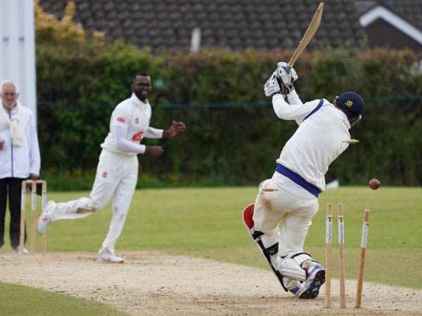 Ashburton's Arun Karthick on his way to a three-wicket haul against Babbacombe<br>credit: Julian Preston