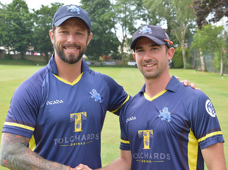 Welcome aboard! Peter Trego (left) is greeted by Devon captain and former Somerset team-mate Alex Barrow before the game against Wiltshire at Warminster