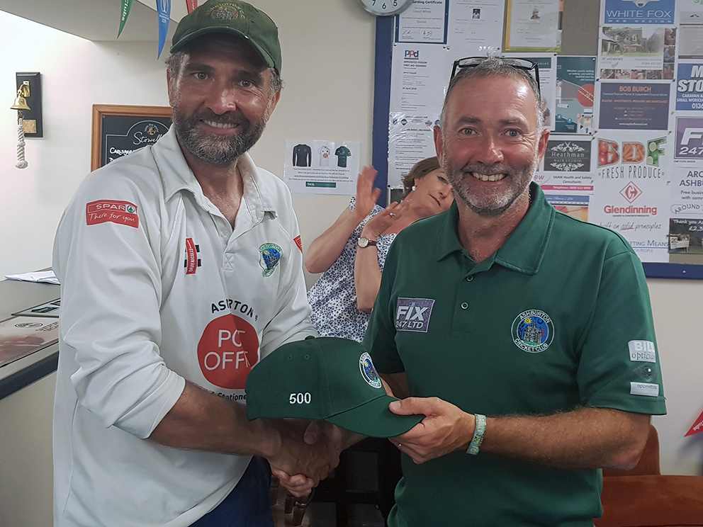 Cap that! Marcus West (left) receives his 500-wicket club cap from chairman Nick Yabsley