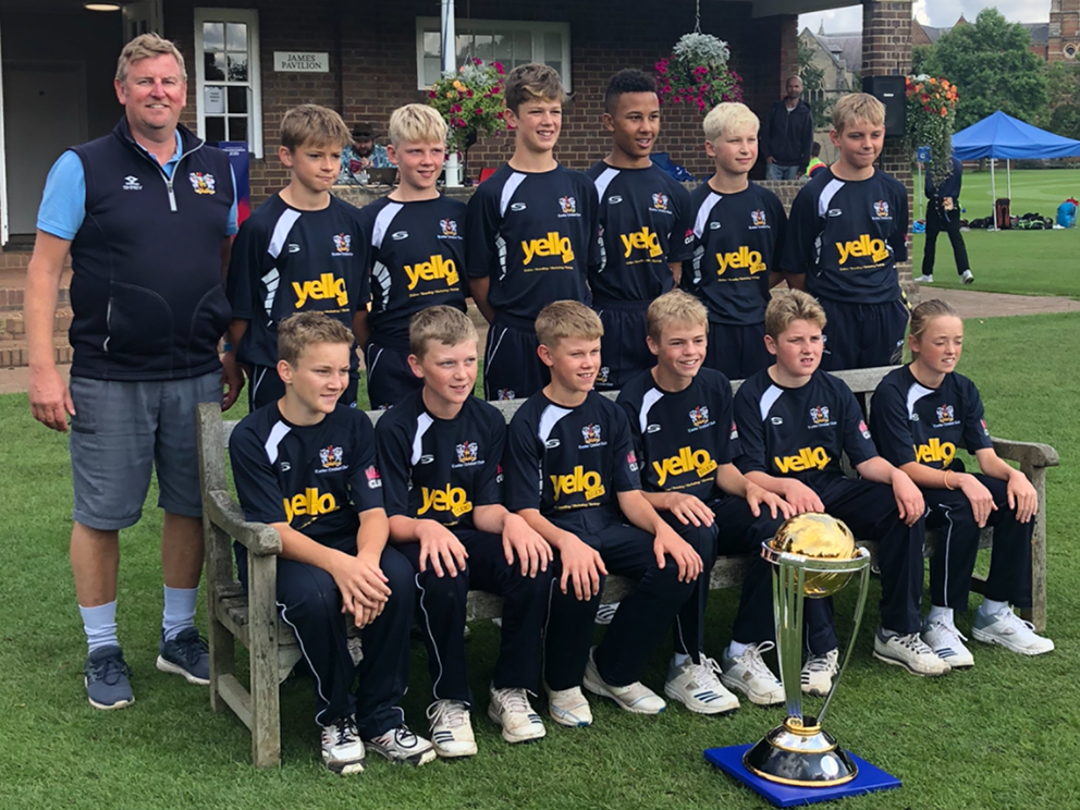 The Exeter U13 squad at Rugby School pictured with the World Cup won by England in last month's final at Lord's. Back (left to right): Mark Gribble (coach), Tom Wraith, Noah Lovedale, Felix Willis, Hugo Hepburn, Fin Hill, George Russell. Front: Freddie Cockram, Zach Vukisic, Oliver Gribble, Harry Williams, Rory Cooper-Smit, Georgia Read