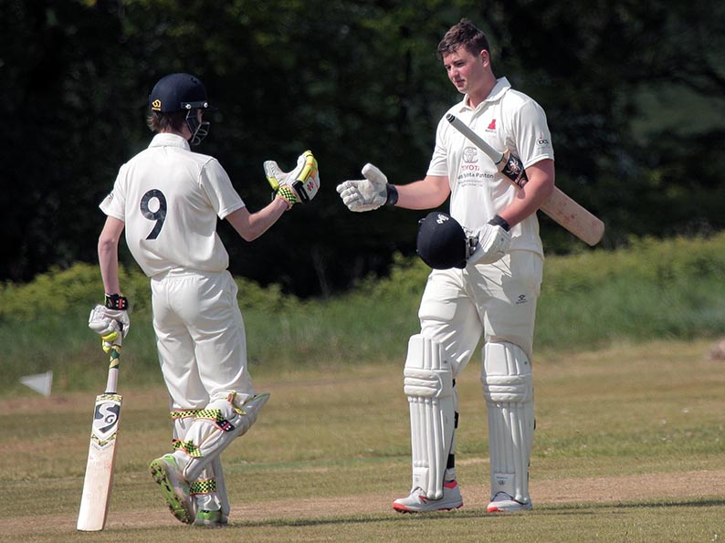 Noah Wright (right) is congratulated by Sam Woodcock on reaching his century against Plymouth CS&amp;R<br>credit: All pictures on this page courtesy of Al Stewart
