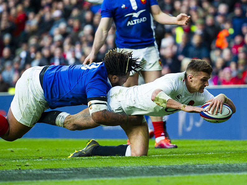 England fly-half Henry Slade dives for the try line in the Six Nations win over France