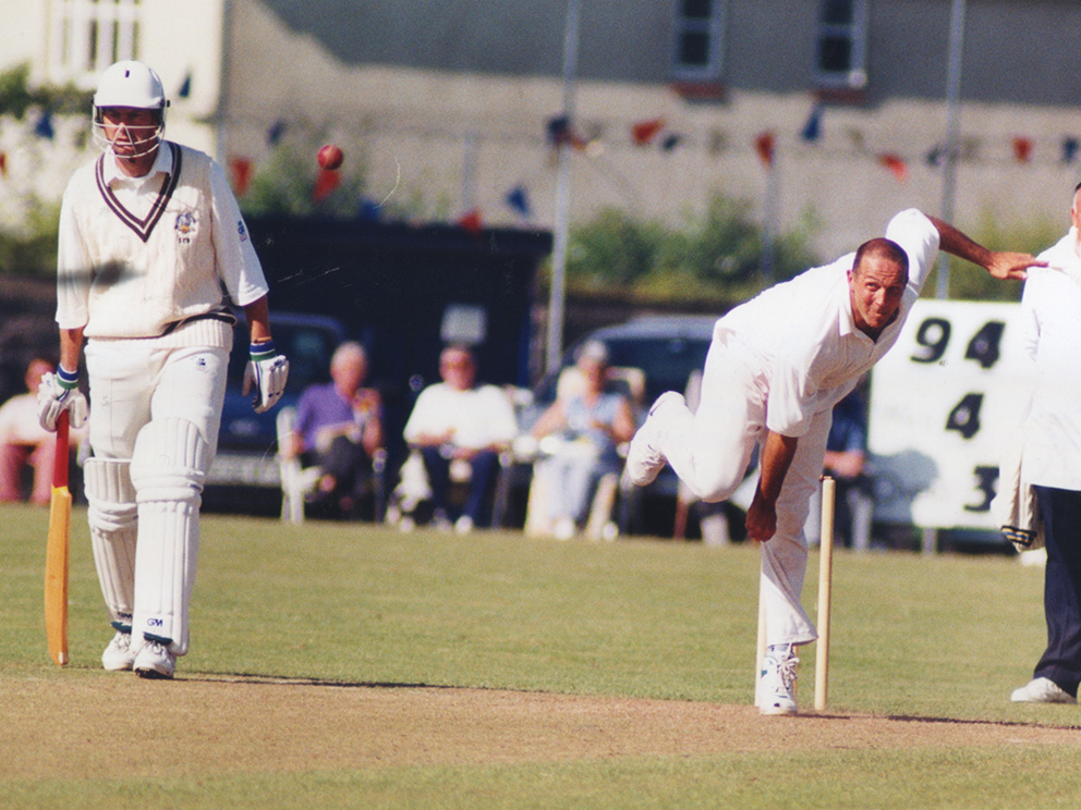 Keith Donohue bowling for Devon against Surrey at Bovey Tracey in the 1998 MCCA Cup semi-final. Devon won and went on to defeat Shropshire in the final at Lord's