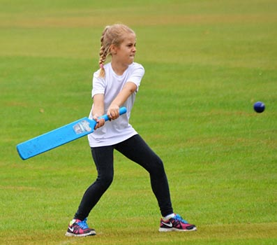 Esmee Stock, aged 9, showing her batting skills at the Ipplepen Festival