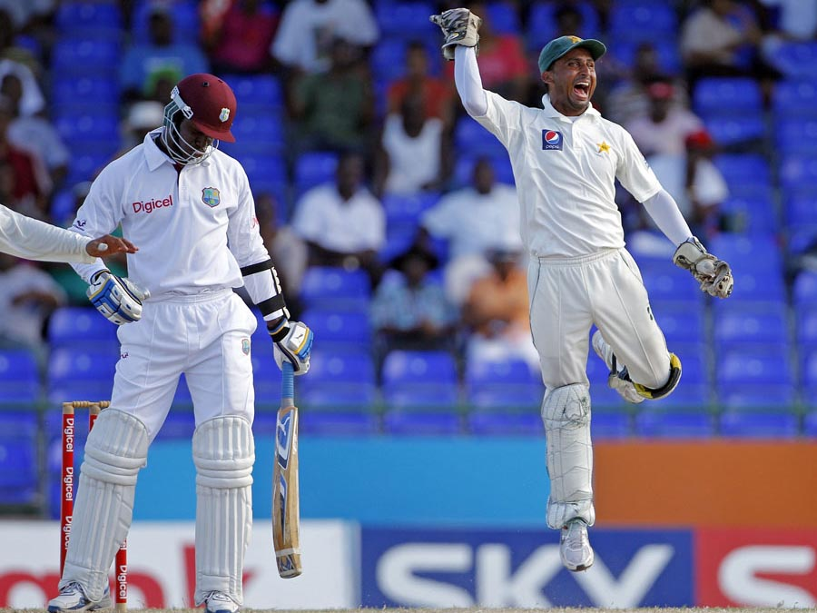 Mohammad Salman celebrates the wicket of Marlon Samuels in a Test match