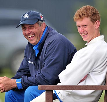 Keith Donohue (left) shares a joke with spinner Jamie Stephens during a break in play