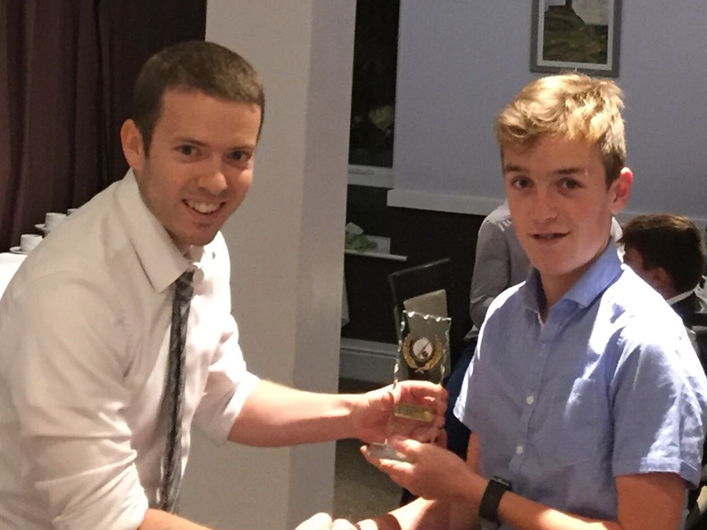 Ashburton 2nd XI captain Chris Yeo presents Jake Pascoe with the team's batting award for 2018 - see story below