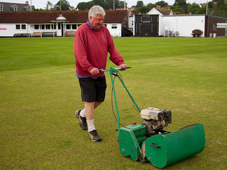 Soon be summer! No doubt Seaton groundsman Peter Anderson will have the Court Lane square in tip-top condition when Devon pay a visit in April