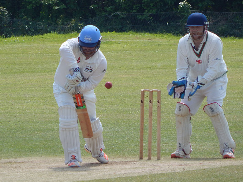 Dan Bowser on his way to 75 for North Devon against Bradninch