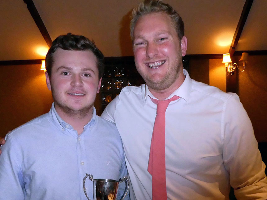 New Bovey captain Toby Codd  (left) collects the leading wicket-taker trophy from outgoing skipper Peter Bradley at the Bovey Tracey awards evening<br>credit: Geoff Coish