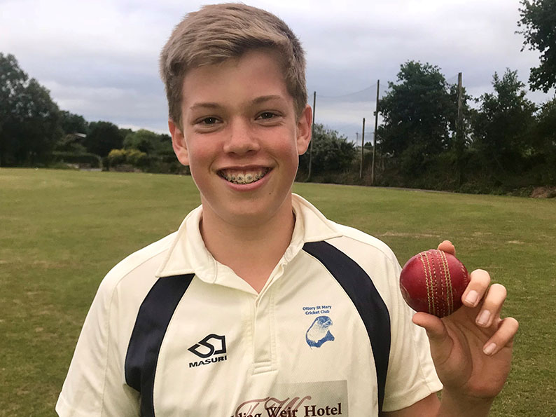 Max Mayor with the match ball he will keep as a souvenir after claiming six wickets for no runs in Ottery U14s' win over Thoverton<br>credit: Mark Tyler
