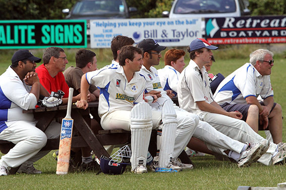 Players and spectators enjoying the cricket at Topsham