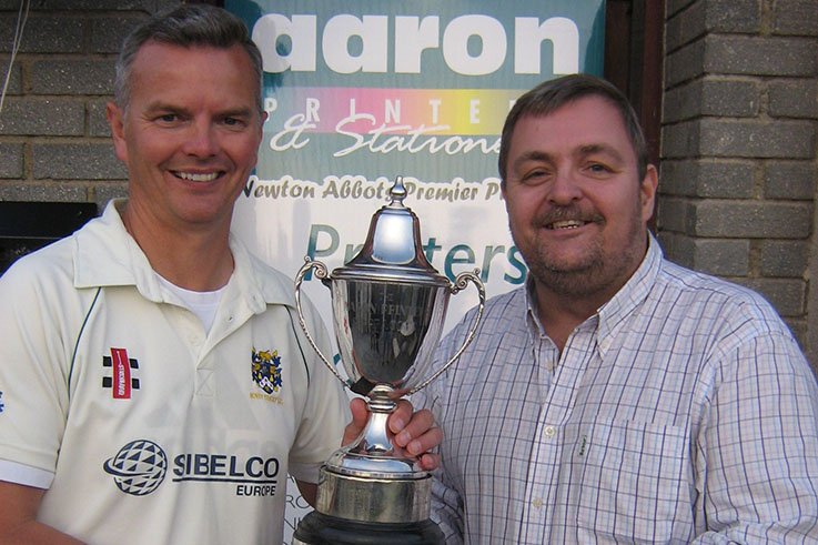 Marcel Massey of Aaron Printers handing the cup over in 2015