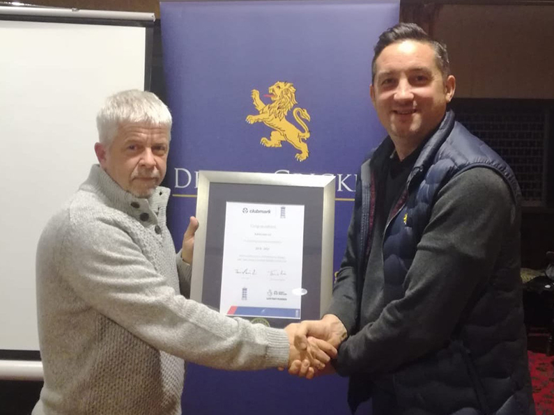 Ashburton chairman Jerry Crouch (left) is pictured receiving the ClubMark award from Matthew Theedom of the DCB