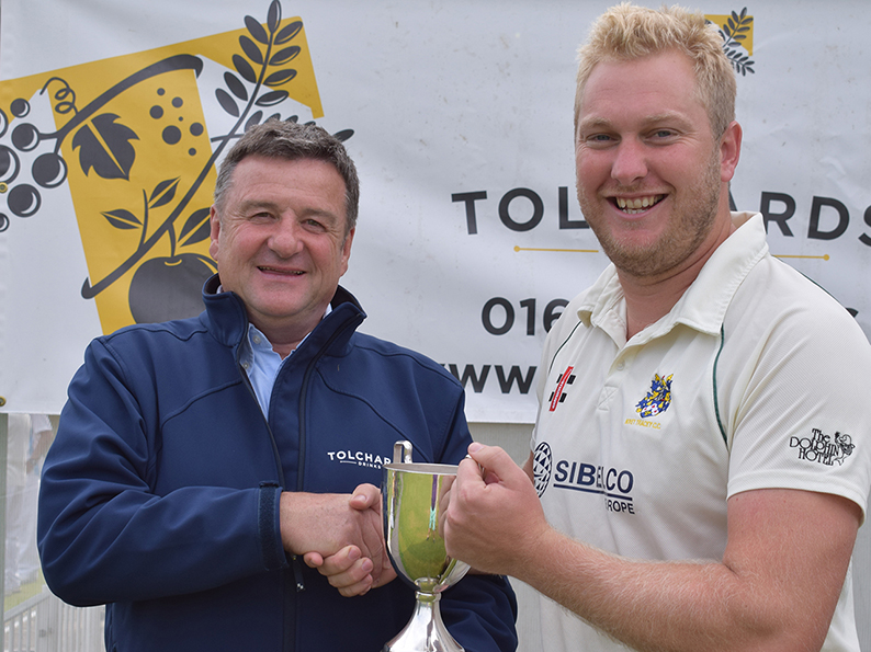 Jim Mardell of Tolchards hands the DCL Premier trophy over to Bovey Tracey's Pete Bradley