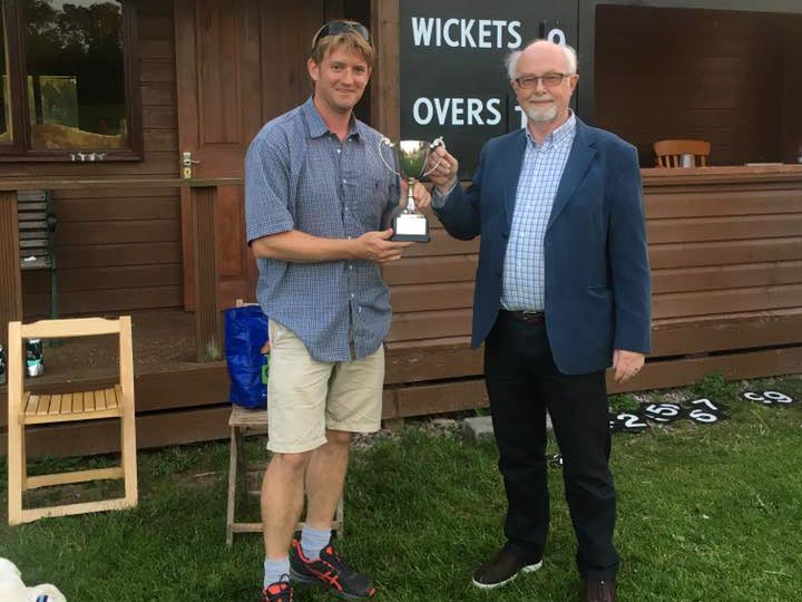 Ben Coe of Cheriton Fitzpaine collecting the League of Friends Cup from sponsor Andy Davis