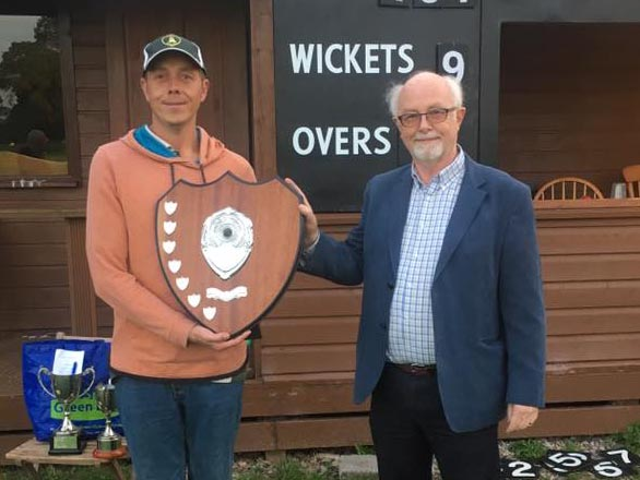 Andy Cork of Newton St Cyres with the League shield, presented by Andy Davis of sponsors Ashgrove Kitchens