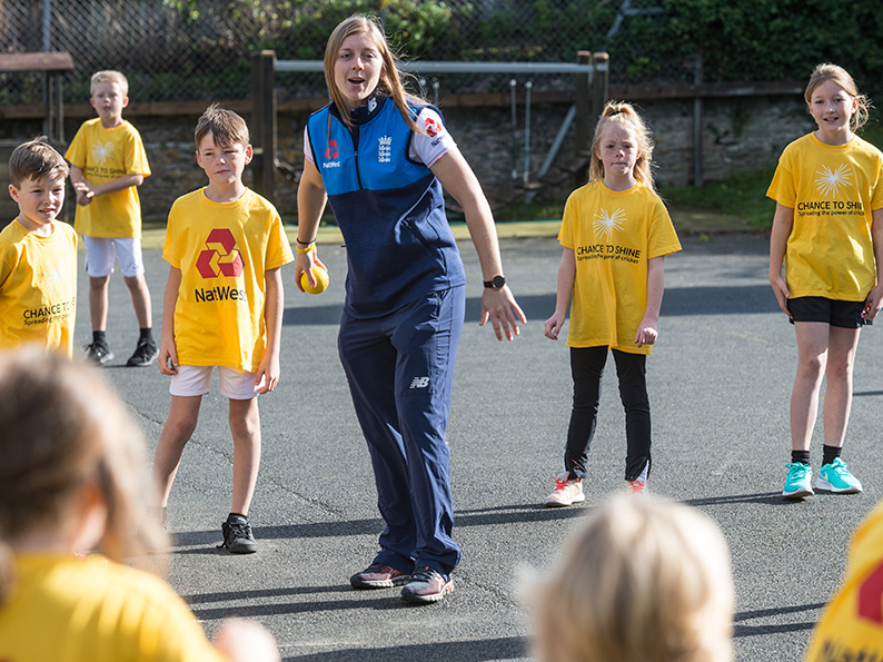 Heather Knight running a training session at her old school