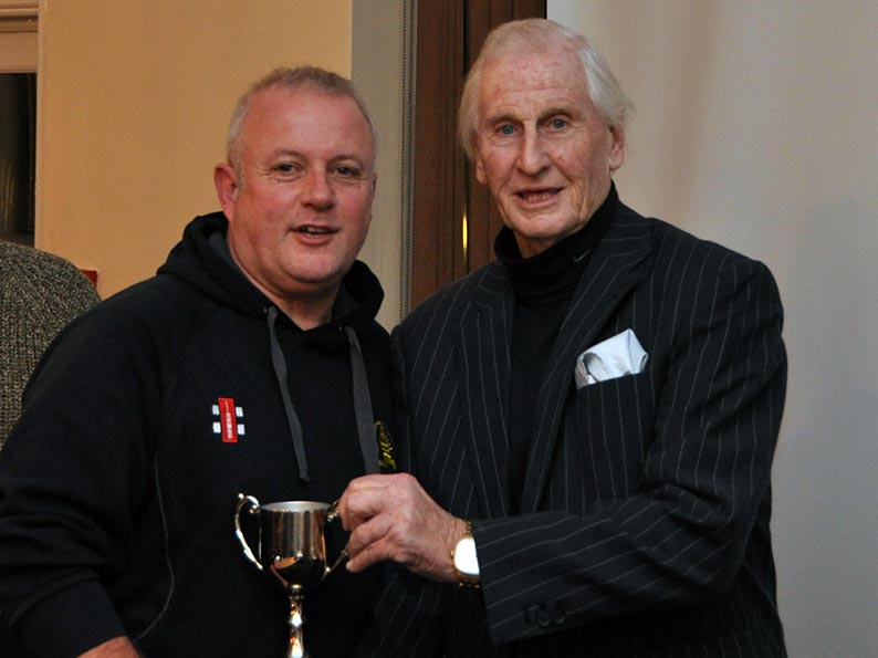 Paul Mitchell (Abbotskerswell) receiving a trophy from Stuart Munday