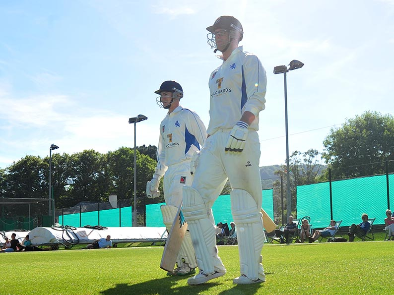 Tom Ansell and Liam Lewis going out to open the batting for Devon against Cheshire