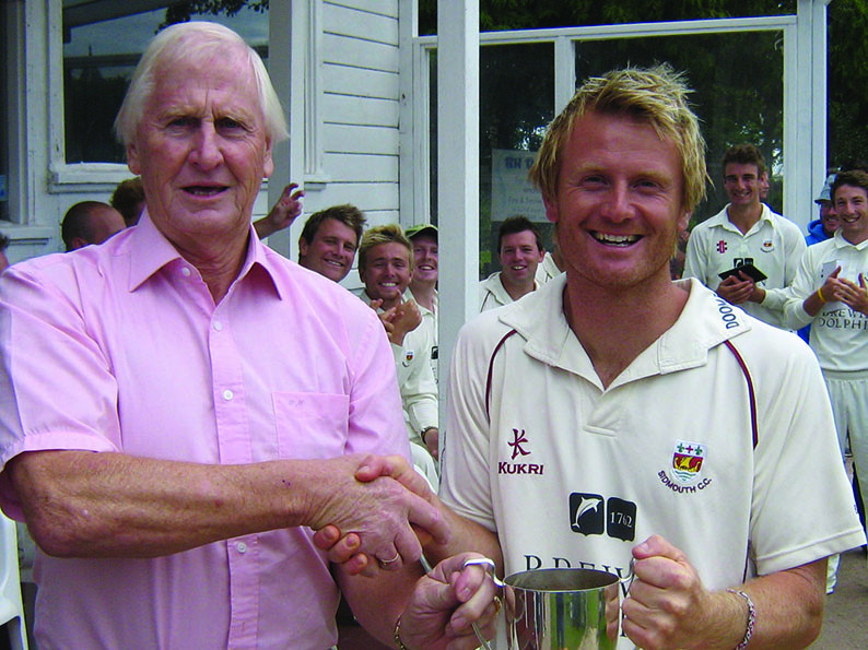 Stuart Munday (left) presenting the Devon Cup to Sidmouth's Will Murray