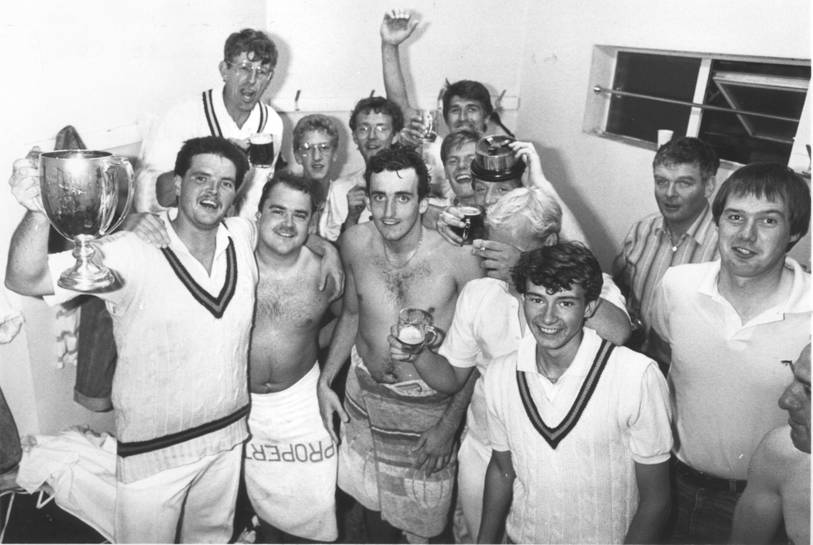 Chris Kelmere leads the dressing room celebrations after Babbacombe's win in the 1987 Narracott Cup final