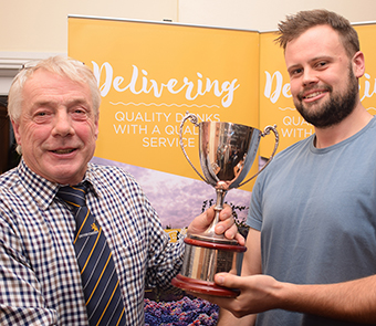 League chairman Nick Rogers (left) hands over the player-of-the-year trophy to Kilmington's Tom Gooding