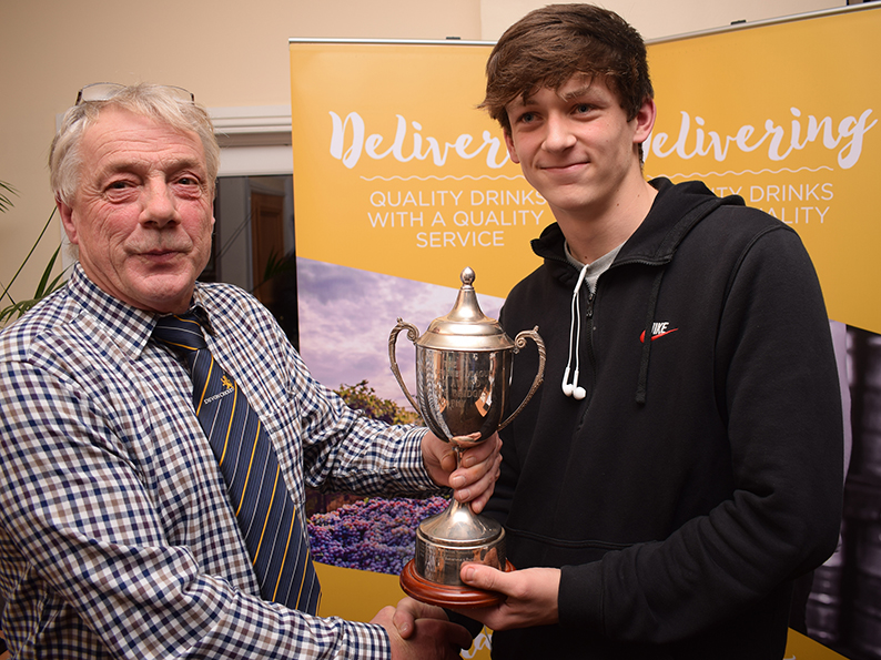 Cameron Kidd, the Tolchards DCL young cricketer of the year, receiving the Bob Bridges Trophy from league chairman Nick Rogers