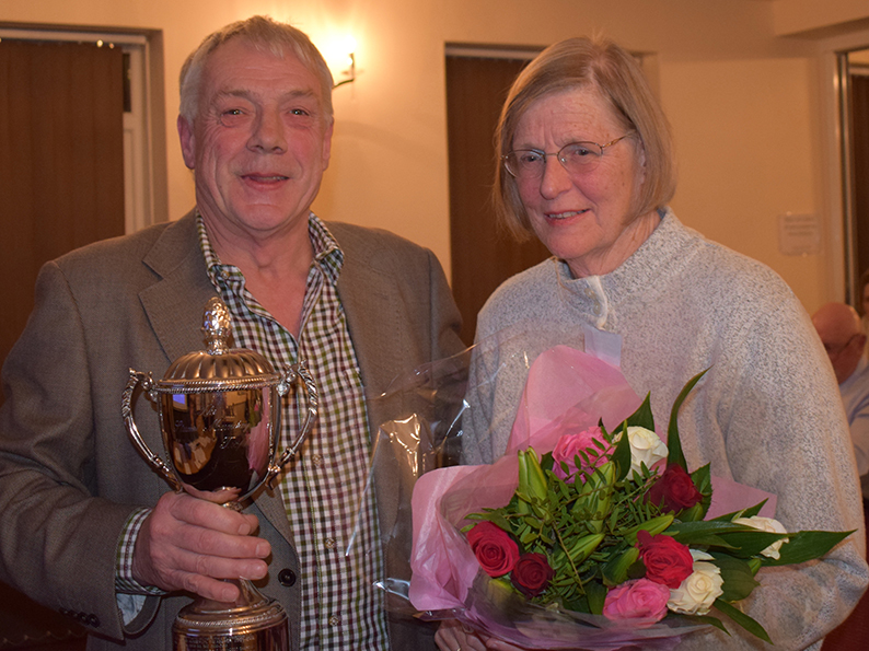 Tolchards DCL chairman Nick Rogers (left) presents the Stuart Munday Trophy to Sheila Harding for services rendered to the league<br>credit: Conrad Sutcliffe