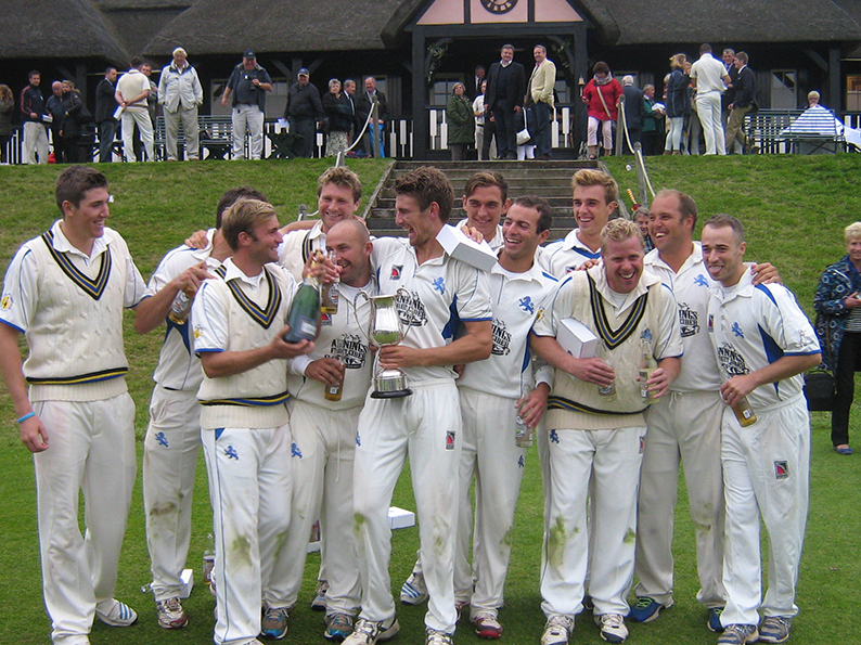 Devon in front of the Wormsley pavilion about to celebrate their win over Oxfordshire in the 2014 final