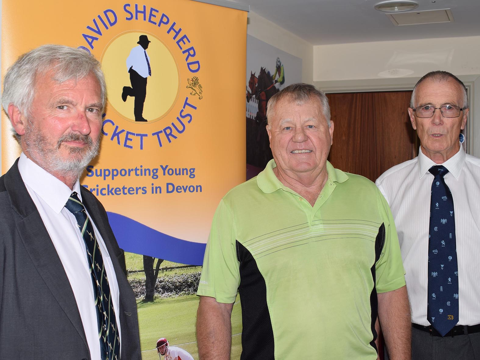 Jack Davey (left) with DSCT chairman Guy Curry (right) and guest speaker Mike Procter at a fund-raising lunch for the cricket charity<br>credit: Conrad Sutcliffe