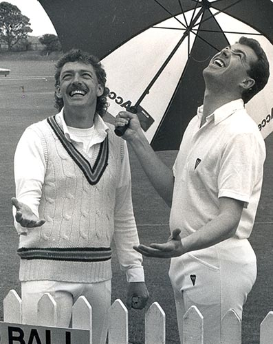 Julian Smith (left) and Exmouth opposite number John Tierney during a rain break in the 1991 season