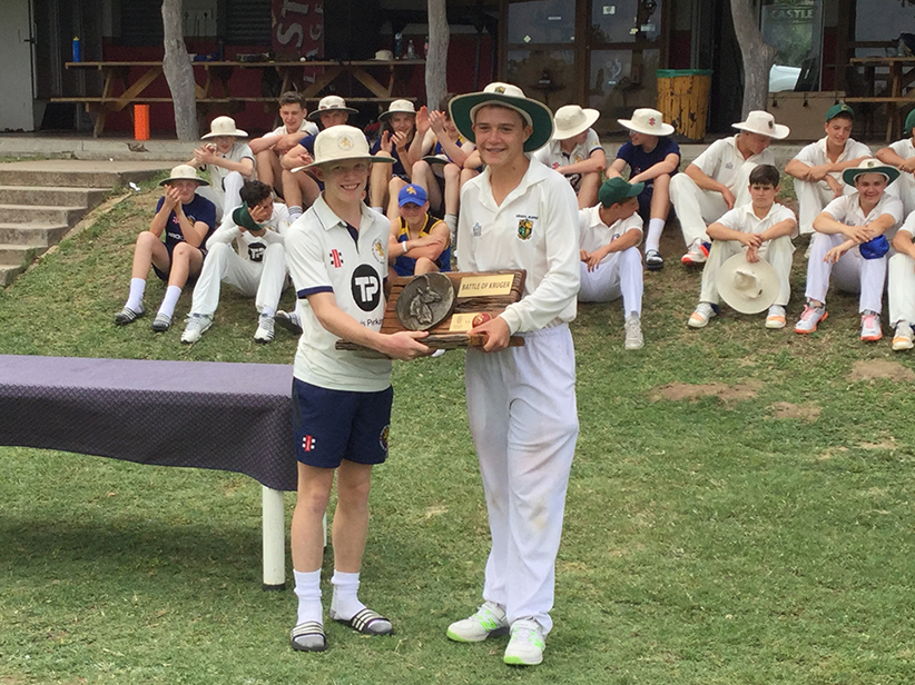 Jasper Presswell receiving the Battle of Kruger Trophy from his opposite number