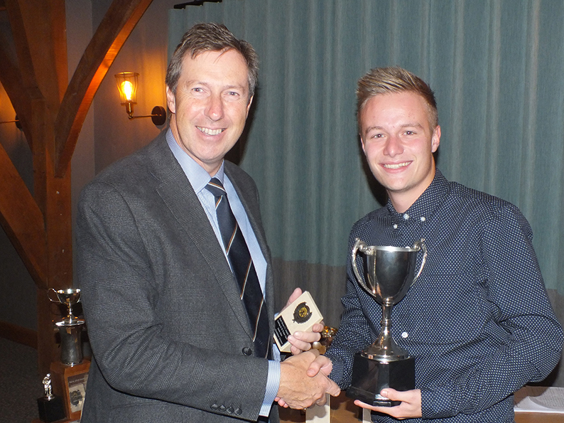 South Devon CC president Chris Hart hands over the bowler of the year trophy to 1st XI captain James Allen