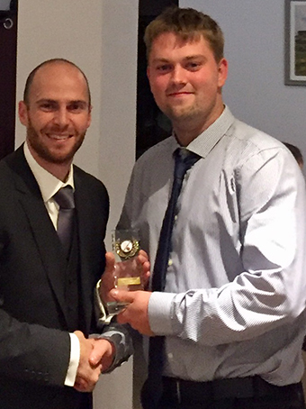 Ashburton 1st XI captain Ashley Berry presents Tom Durman (right) with the club's bowler of the year award