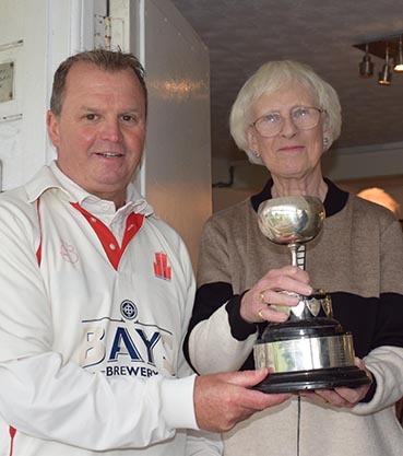 Cup winning captain Terry Farkins collects the trophy from Angela Glendenning, a Brockman family member