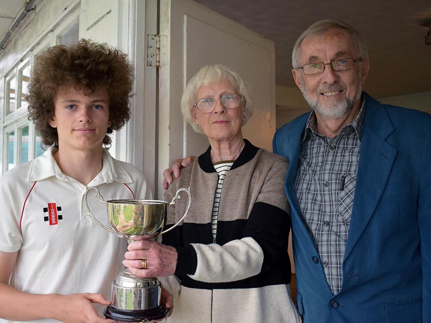 Man of the match Luke Medlock with his trophy and Angela Glendenning and Frank Heal, who made the award