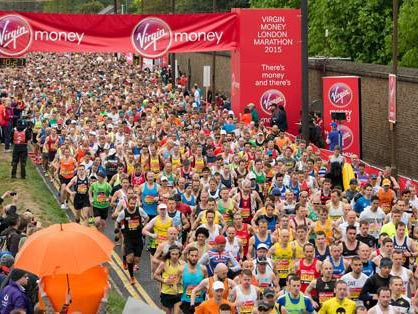 Runners stream away from the start of the London Marathon