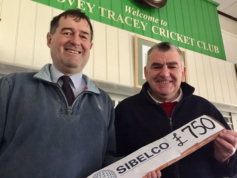 Keith Lee (left) handing over the grant to Bovey Tracey chairman Nigel Mountford