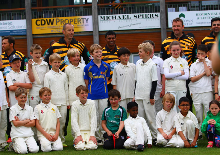 Lashings All Stars mingle with youngsters during the game at Mount Wise earlier this year - photo: Chris Cottrell