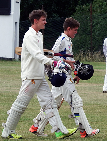 Sonny Baker (left) and Elliot Hamilton make their way off after steering Devon to victory