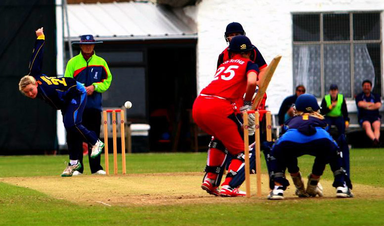 Emily Edgcombe bowling against Wales