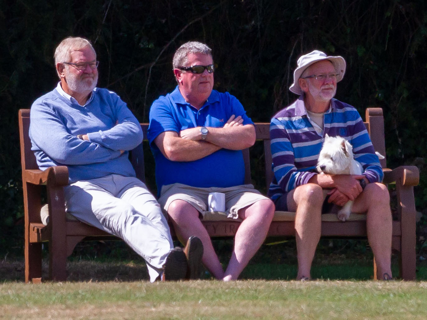 Paul Bradley (far right) and friends enjoying the view from the boundary during a game at Bovey Tracey. Photo: Mark Lockett