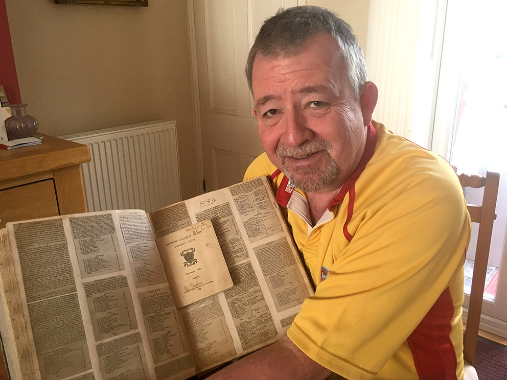 Conrad Sutcliffe about to dive into the 140-year-old scrapbook for a trip into the past<br>credit: P K Bennett