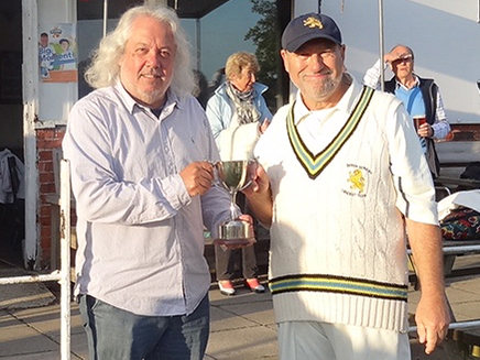 Devon captain Neil Matthews (right) receiving the Vase from Len Attard, the SW Counties National administrator