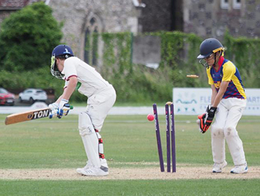 A wicket falls during Exeter's win at South Wilts in the regional festival final