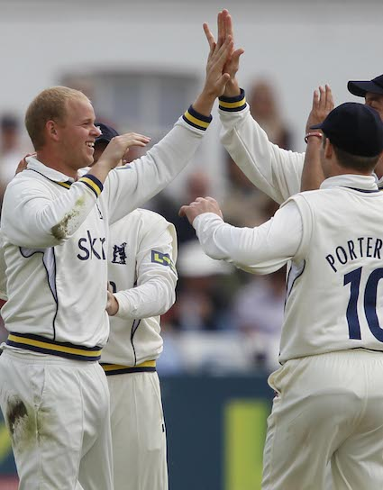 Chris Metters celebrates taking a wicket for Warwickshire – Picture: Pinnacle Photo Agency