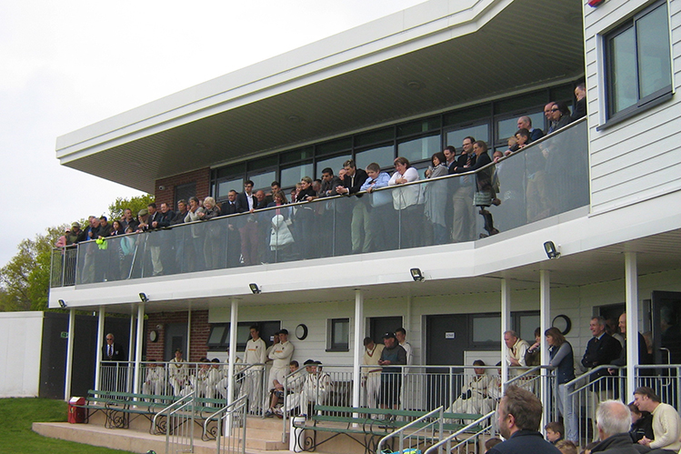 A packed balcony for the opening of the new Exeter pavilion