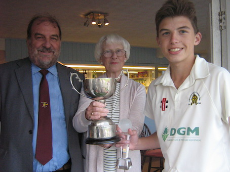 Man of the match Elliott Adams collecting the cup from Tim Chapman and Angela Glendenning