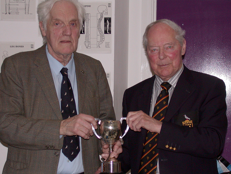 Colonel Ronnie Potts (right), at the time president of Cornwall CCC, presents the Arthur Lugg Cup to Geoff Husband in recognition of more than 40 years' service to the club<br>credit: Michael Weeks / Cornwall Cricket